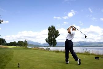 Golfer at Loch Lomond, Scotland.