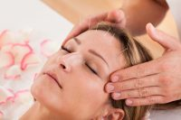 Woman Undergoing Facial Acupuncture Treatment