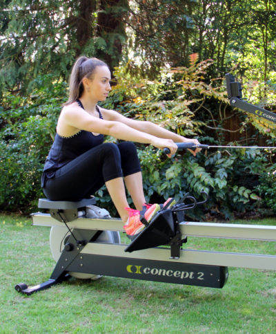 Lady using a rowing machine