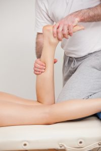 Podiatrist manipulating the ankle