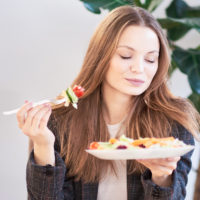 Image of woman enjoying a healthy meal
